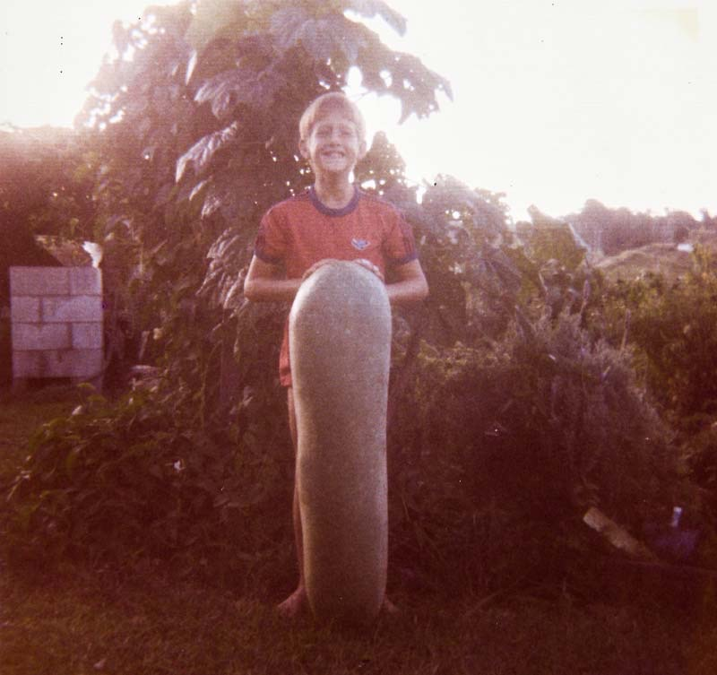 Isabell's son Ricky holding a giant cucumber