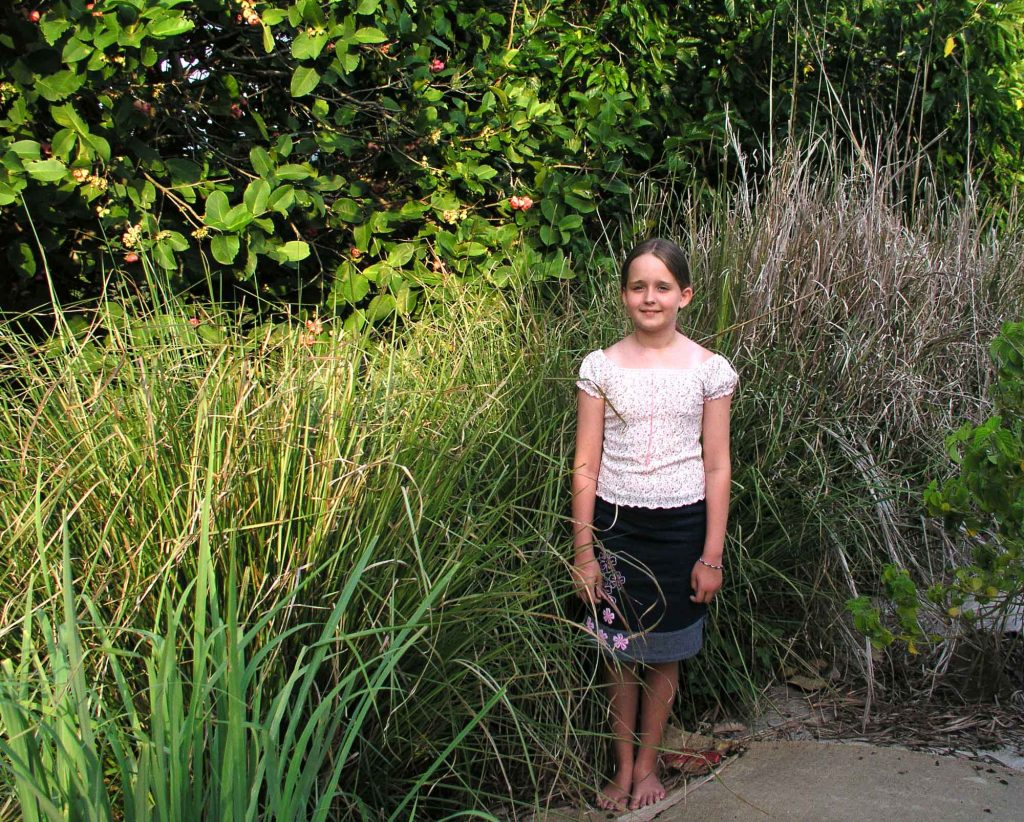 Aleisha standing with Vetiver Grass