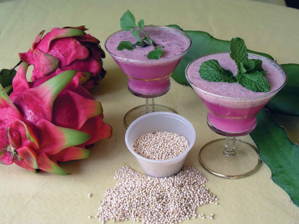 A. pink dragon fruit B. dragon fruit in a smoothie blended with millet sprouts C. millet seed.